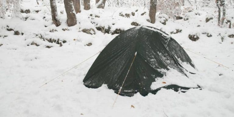 Camping in Winter How To Handle A Snowstorm While Camping Feature Image